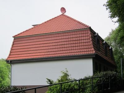 Haus 5 mit rotem Dach